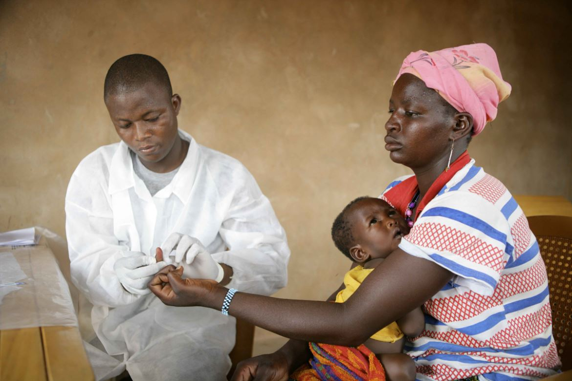 An HIV/AIDS test in progress. HIV/AIDS Prevention care and treatment in Burkina Faso, Africa HIV: More than 117,500 patients, including 35,131 orphaned children are being cared for through a UNDP programme of support to community organizations involved in addressing HIV and AIDS and providing psychological support to AIDS patients. The programme supports 172 civil society organizations and six national networks of associations, helping to carry out 90 percent of all HIV tests nationwide. It trains all of these associations and connects them with one another. UNDP established the programme and mobilized funding from partners like France, Belgium, Austria and the Global Fund.